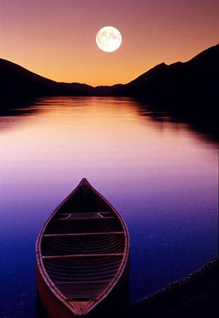 nothing surpasses the sight of the full moon reflected in a placid body of water, backed by natural landscape features that provide their own character to the scene.