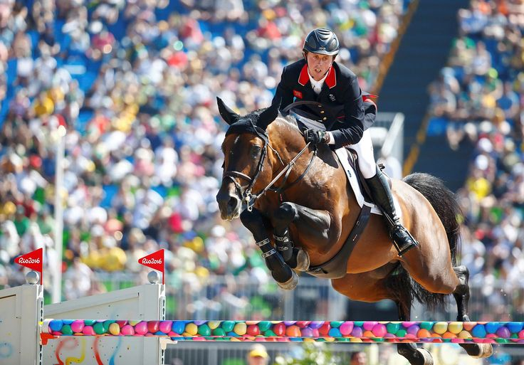 Ben Maher of Great Britain riding Tic Tac jumps in the preliminary jumping team qualification at the Olympic Equestrian Center on August 14, 2016.