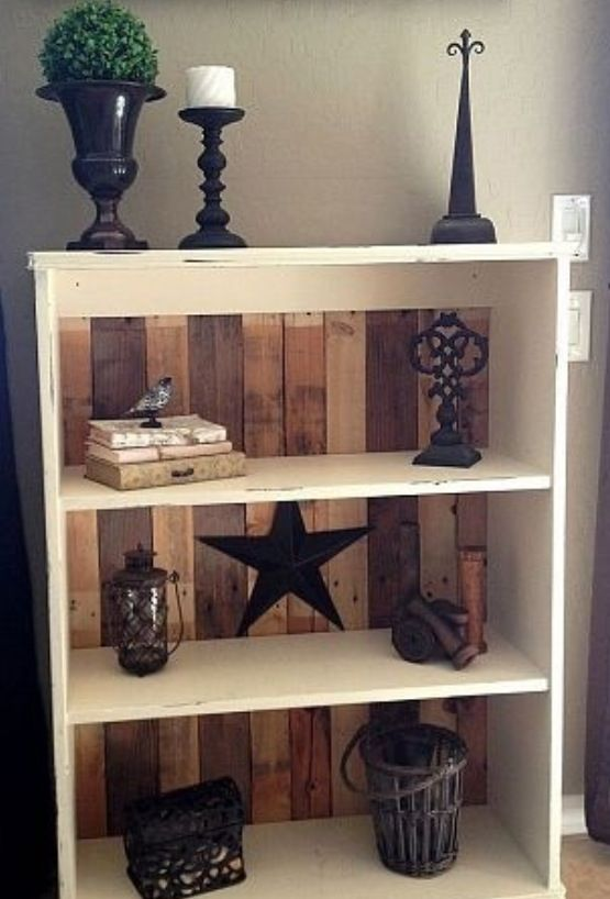 Replace backs of cheap bookcases with pallet wood. Adds sturdiness, plus looks great!! I should try this with our bookcase...