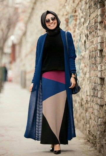 Black shirt, black scarf, long blue cardigan, blue/pink/tan/black skirt, black heels, black bracelet