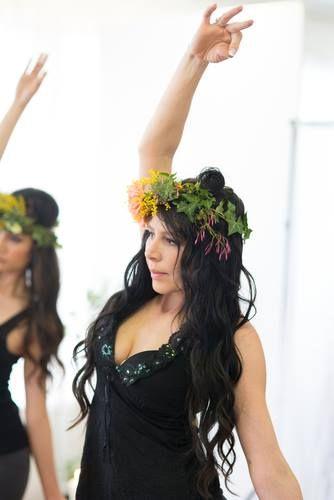 Yoga pose. Goddess yoga photoshoot. Flowers and vine headpiece. Hair. Black halterneck top