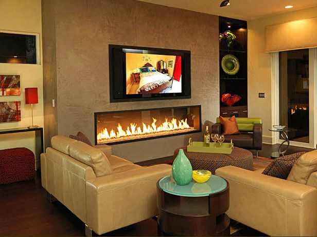 Artful Fire ~~ Great Colors A horizontal, simple gas fireplace appears as another piece of artwork in this fun, elegant living room. Colorful glass work stands out against the natural wood of the shelves and surrounding neutral furnishings. Design by Studio M.