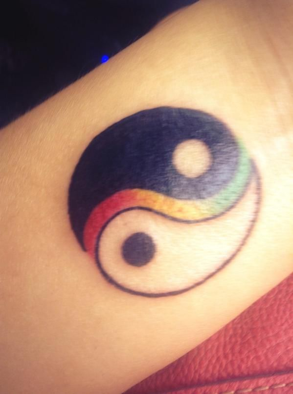 Yin-Yang: A clockwise taijitu with a wide interface (sometimes considered a representation of taiji) between the elements, made of the Jamaican national colors.