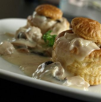 Vol Au Vent - A delicious Dutch take on a chicken pot pie served over baked puff pastry cups with chicken meatballs in a savory mushroom cream sauce.