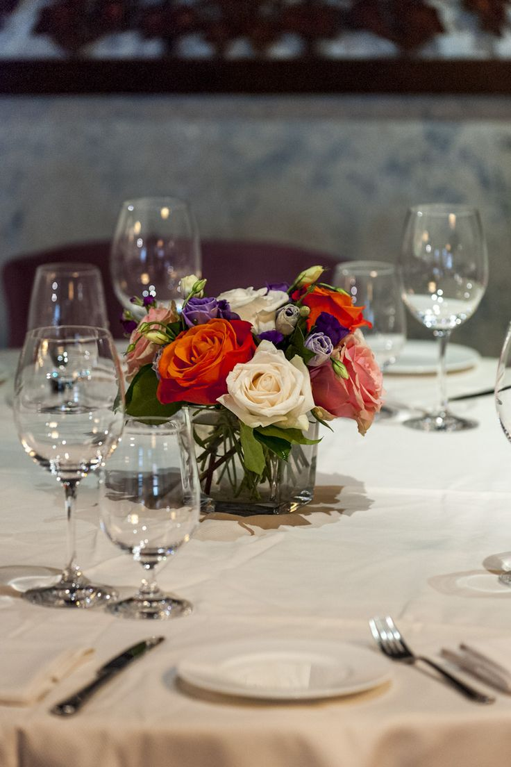 Petite floral center pieces with bold colours to add the perfect pop of colour to your wedding reception.