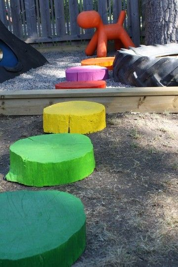 Make It: Rainbow stepping stumps...beautiful but easy  .....*i have the wood from the tree butchering....!!! I Can do this for the children's garden!! yay! thank you!