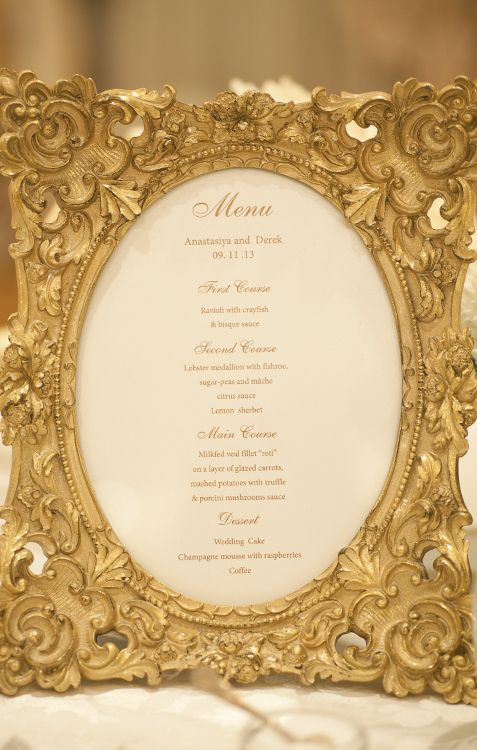 Your wedding reception menu in a gold antiqué frame, is destined to steal the spotlight