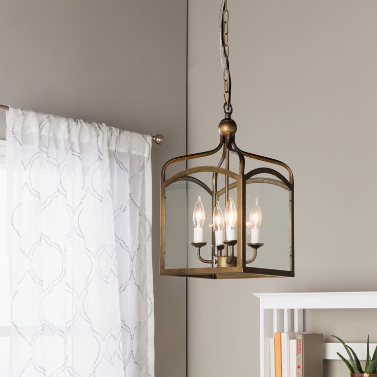 Combine traditional beauty with modern convenience in this ashley bronze foyer hanging lantern this gorgeous fixture features 4 lights and a bronze finish