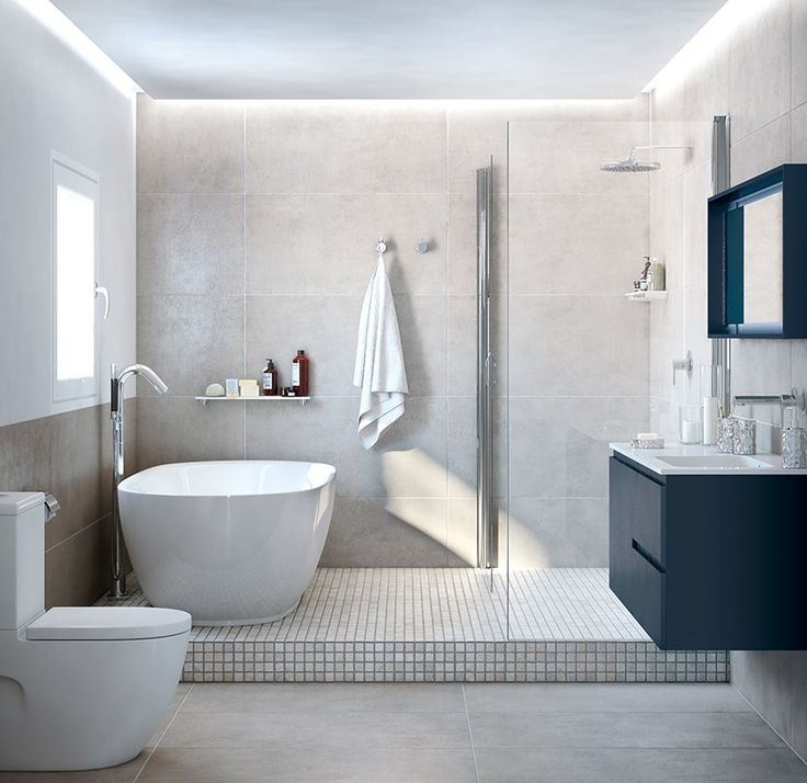Baño en tonos claros. Zona de ducha y zona de bañera.