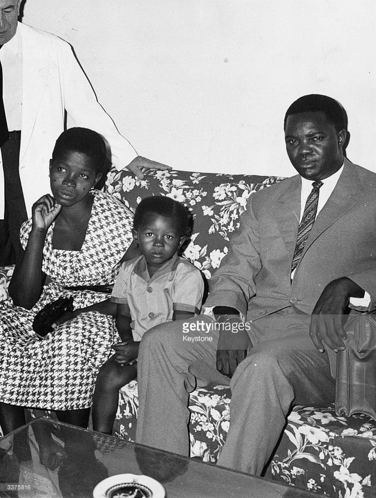 Wife of murdered Congolese leader Patrice Emergy Lumumba (1925 - 1961) first Prime Minister of the Democratic Republic of the Congo, with her son and brother of her husband.