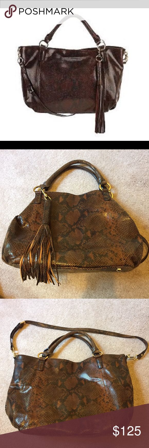 "NEW G.I.L.I. Leather Roma 2 Espresso Brown Lizard NWOT Dark and light brown shiny snake print large handbag. Measures approximately 16""W x 12""H x 6-1/2""D with a 16"" to 18"" strap drop and a 7"" handle drop. 100% leather. Lined interior, back-wall zip pocket, two front-wall slip pockets. Gold hardware; double handles; removable, adjustable strap; hanging removable fringe tassel charm; four bottom feet; center magnetic snap closure; interior hook closure. G.I.L.I. Bags Shoulder Bags"