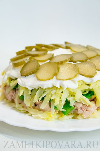 Салат с печенью трески и солеными огурчиками...this is def a must for a salty craving...A layered salad with shredded potatoes, pickles, green onion, and canned fish liver (it's really good).