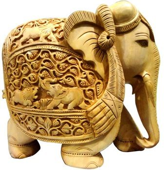 A beautiful carved wooden elephant is a must have to add that sophisticated look