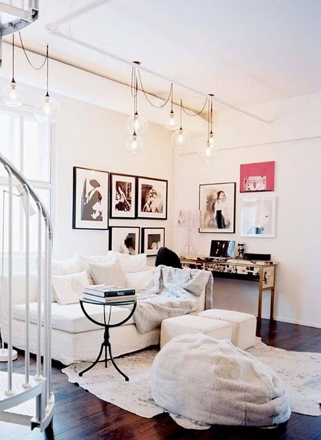 Fresh and comfortable looking room with lots of light and photographs. My kind of space.
