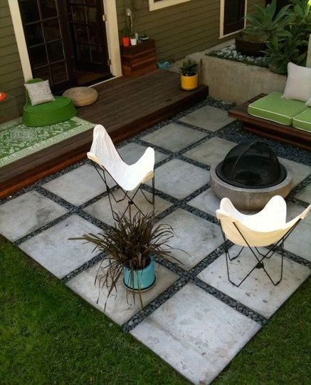 Easy and cheap patio set up; Build a step and planter box along the house.  Layout concrete pavers for a patio space