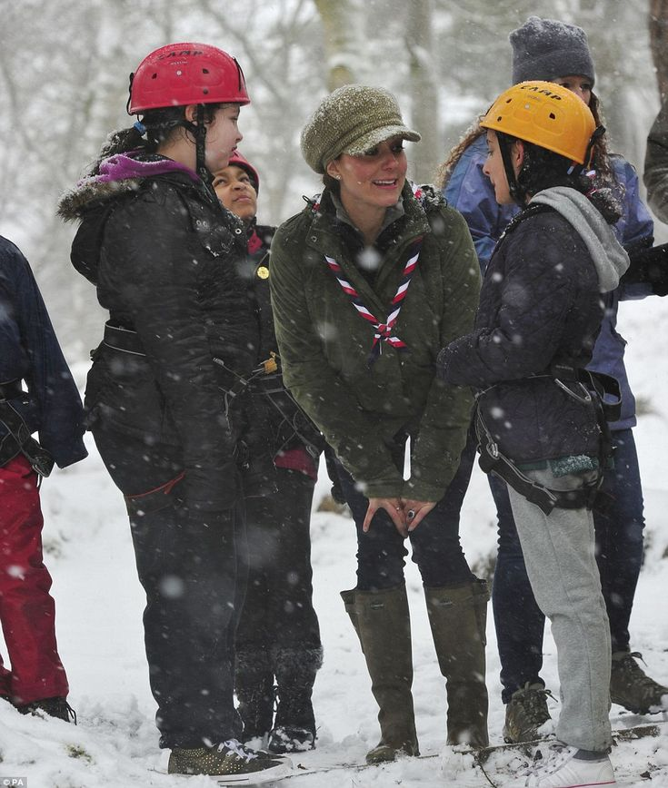 Down with the kids: After lunch, the Duchess met children from Scout and Cub groups who tried some tree climbing