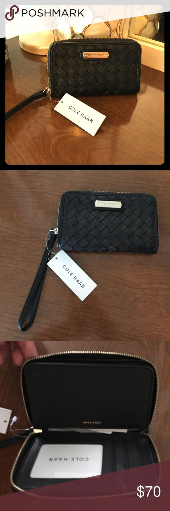 """Cole Haan smartphone wallet in woven black Cole Haan smart phone wallet in woven black leather. Has wrist strap for ease of carrying! Zips open to show clear ID window and card slots, plus space for storing phone. Will fit Galaxy or iPhone 6. NWT. Measures 3.75"""" x 5.75"""" x 1"""". Cole Haan Bags Wallets"""