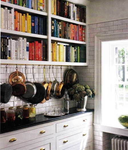 love the cook books in love with the shallow counter and hanging pots too!