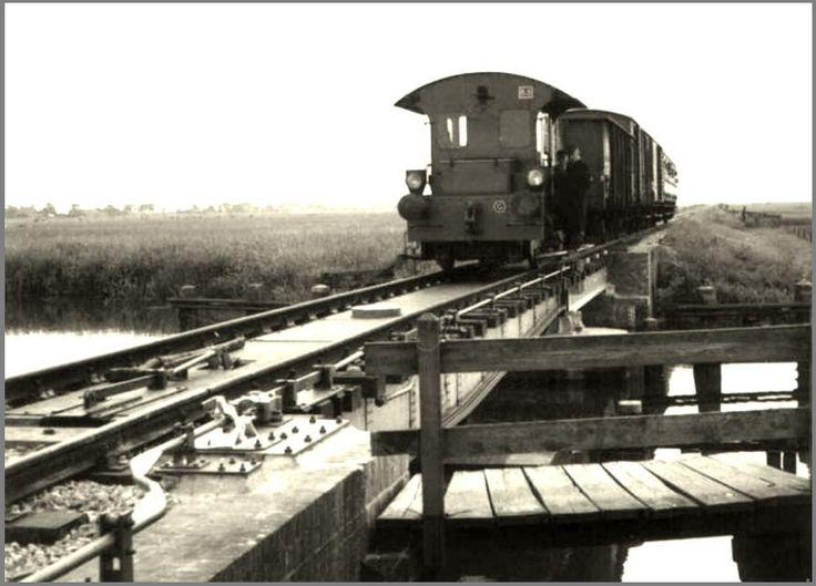 Tram over brug bij Follega