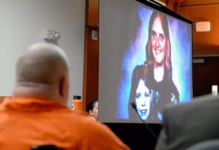 Marvin Gail Owens watches a video put together by family members of Deborah Owens during his sentencing Thursday in Butte County Superior Court in Oroville. He was sentenced to four years for voluntary manslaughter. (Bill Husa — Mercury-Register)