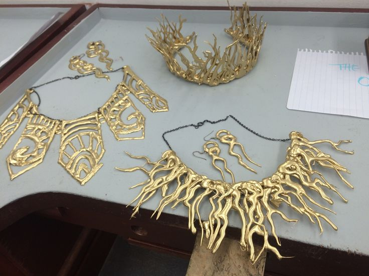 Using hot glue to create costume jewelry spray painted gold or any color you need to match your project.