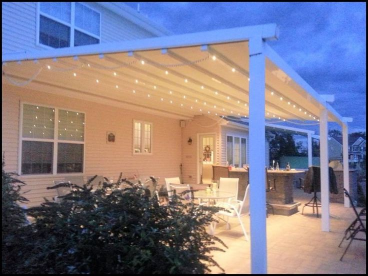 European style retractable awnings with lighting create outdoor rooms in Chester County