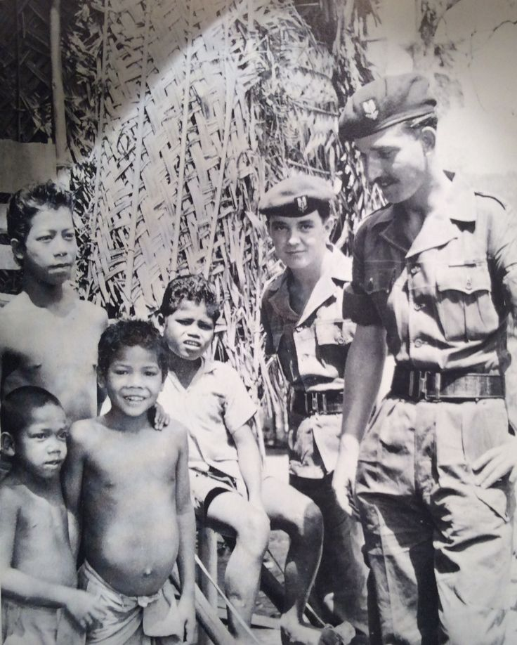 "22 SAS troopers conducting ""Hearts & Minds"" during Malayan Emergency"