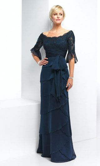 Dark navy blue mother of the bride dresses can be worn for many other formal occasions. This one has long sleeves to the elbow and a chiffon tiered floor length skirt. If you are curious as to what a dress like this would cost when made to order then please contact our design firm at www.dariuscordell.com (affordable custom designs & replicas available.)