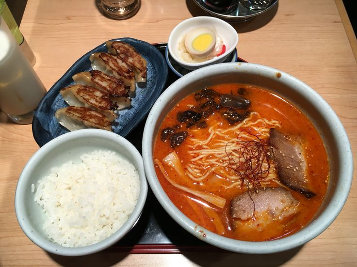 Spicy miso soup noodles with pork served with fried pork dumplings and rice