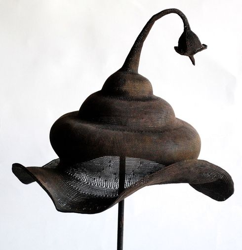 Sumbawa, Indonesia ceremonial copper wire hat, hand plaited fine copper wire woven hat used in ritual ceremonies, featuring a bud ornament atop a long stem on the crown with the brim gently curved upwards into a concave shape.