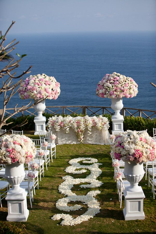White and Blush Pink Wedding Ceremony {Photo: Samuel Lippke}   The flowers in urns on top of columns are beautiful.  Also love the floral drape over the table at the end of the aisle.