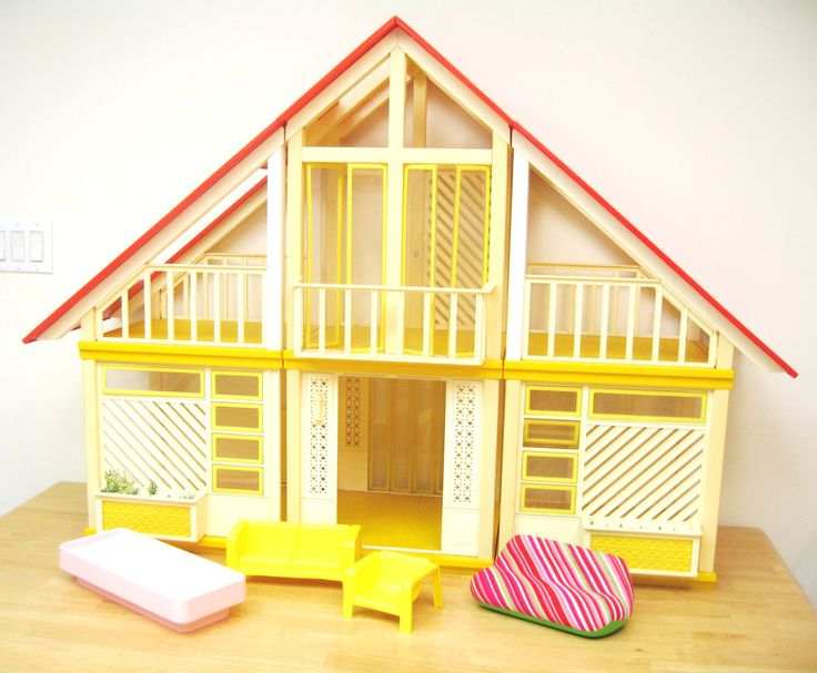 70s barbie dream house, yellow & orange. I don't have this anymore but I did have my original childhood on until about 7 years ago. It was in good shape and I had a few of the plants still. I was not able to sell it at a garage sale or craigslist for $25, ended up taking it to goodwill. Now I wish I kept it & painted it but I'm not broken up about it. I did keep all the furniture I had.