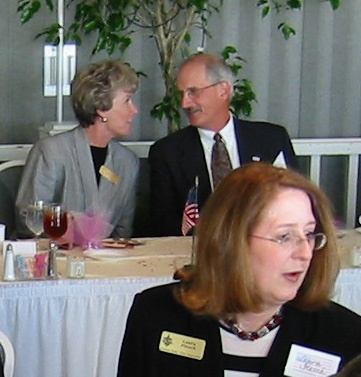 Sarasota Sister Cities President Linda Rosenbluth and Stewart K. Etherington, President of the Eisenhower Foundation of Abilene, Kansas at the head table for  the special Sarasota Sister Cities luncheon was held at the Quay as one of the events for the 100th Aniversary of the founding of the city of Sarasota by Scots and the twinning of Sarasota with Dunfermline, Scotland in October 2002.  SSCA member Laura Flesch in foreground