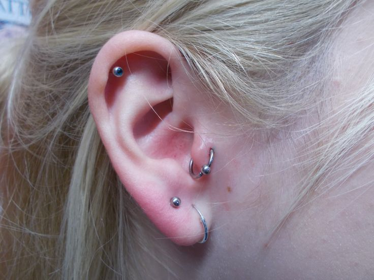 Fresh tragus piercing with a BCR by Sophie
