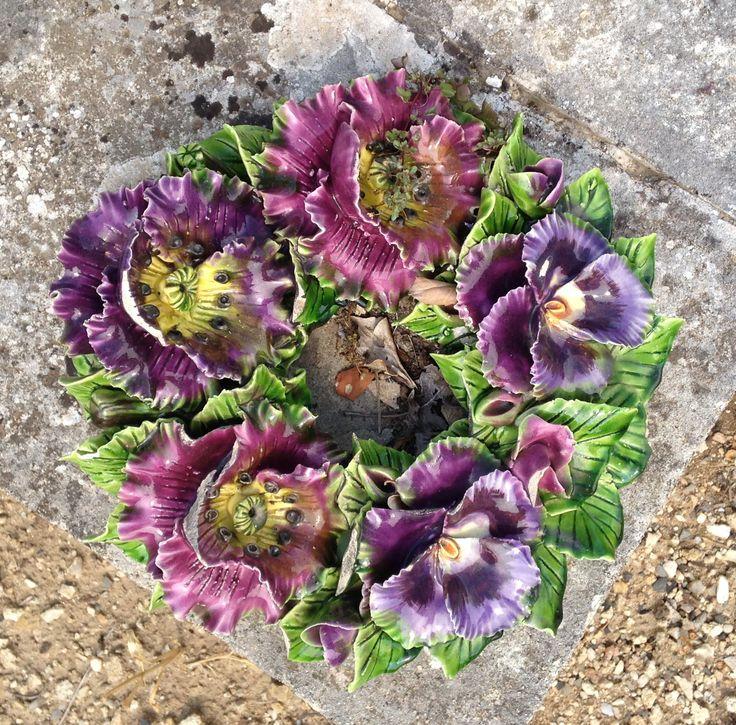 Ceramic Wreath decorated with beautiful flowers. Handmade. Southern part of France.  Krans van keramiek versierd met bloemen op de begraafplaats in Zuid Frankrijk July 2013 #keramiekvoorbuiten