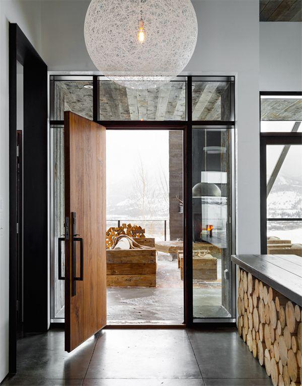 modern mountain house tour entryway with log storage | coco+kelley