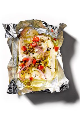 Baked Feta (Preheat oven to 350°. Combine blocks of feta cheese, fresh oregano, thinly sliced red onion, diced tomato, capers, thinly sliced garlic, olive oil, black pepper, and red pepper flakes in whatever proportions seem delicious to you on squares of aluminum foil. (We make one package per person, with about a 2x4 piece of feta.) Seal packets tightly and place on a sheet tray; bake 15 minutes. Carefully open packets, transfer mixture to plates, and serve with baguette slices.)