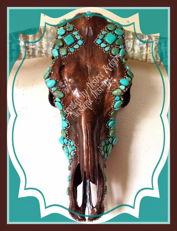 This custom handmade longhorn has a hand paint aged Copper skull. Trimmed out with copper rhinestones and turquoise stones. All of my skulls are