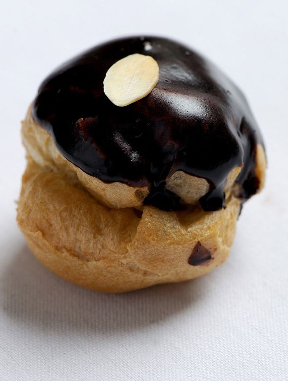 This easy profiteroles recipe from Tom Aikens is the ideal way to finish a dinner party, or to make small desserts to give to friends and family. These profiteroles are filled with a gorgeous vanilla crème Chantilly and covered in chocolate sauce, making these little puffs a pure treat - See more at.