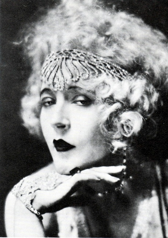 "Mae Murray (May 10, 1885 – March 23, 1965) was an actress, dancer, film producer, and screenwriter. Murray rose to fame during the silent film era and was known as ""The Girl with the Bee-Stung Lips"" She first began acting on the Broadway stage in 1906 with dancer Vernon Castle. In 1908, she joined the chorus line of the Ziegfeld Follies, Murray took her husband's advice and walked out of her contract with MGM, making a powerful foe of studio boss Louis B. Mayer."