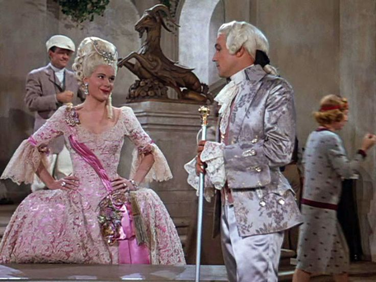 """""""Singing In The Rain"""" - Jean Hagen and Gene Kelly as Lina Lamont and Don Lockwood, shooting the ill-fated talkie The Dueling Cavalier.   Rosco: Lina! We're missing every other word! You've got to talk into the mike!  Lina: [pointing at the bush] Well, I can't make love to a bush!"""