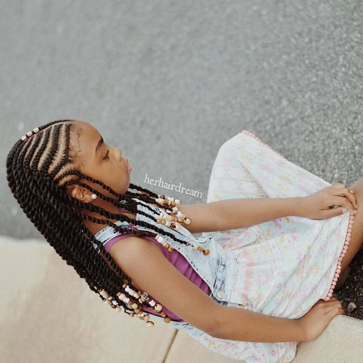 @herhairdream Braids and beads...only difference is I twisted her ends and her individuals in the back!! Using equal Cuban twist hair... She loves it!!