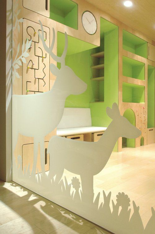 Adorable modern kids area. I love light wood with bright green and white!