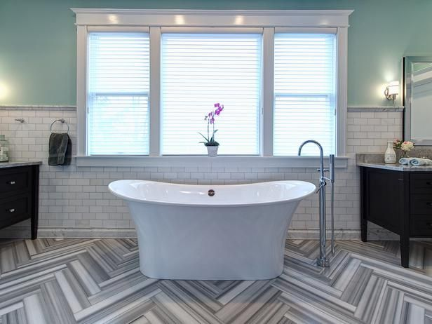Although you might mistake the herringbone floors in this posh bathroom for wood or even a painted detail, it's actually marble that designer Joni Spear had painstakingly cut into 4-inch-wide planks then laid in a specific order to maximize the color contrast between different areas of the stone.: Bathroom Design, Design Ideas, Joni Spears, Master Bath, Bathroom Ideas, Chic Bathroom, Eclectic Bathroom, Herringbone Floors, Bathroom Tile Design