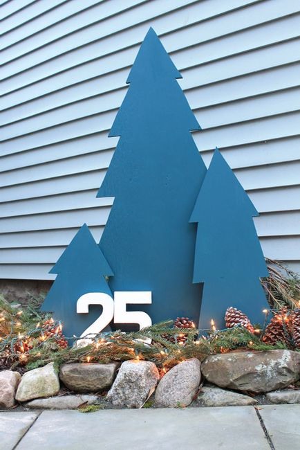 Want some ideas to decorate the outside of your home? Set up these easy-to-make outdoor plywood trees and have a winter look on the porch or in the backyard. Add lights for a festive touch.