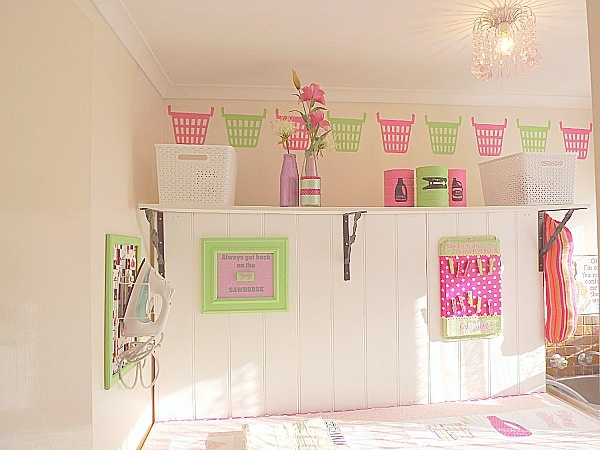 I LOVE everything about this laundry room.  I really like the laundry basket stencils on top of room.