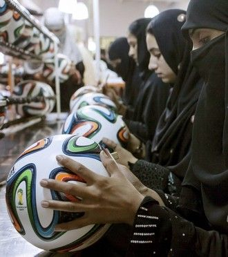 Employees conduct a final check to fix any cavities in the seams of balls inside the football factory that produces official match balls for the 2014 World Cup in Brazil, in Sialkot, Punjab province on May 16, 2014. It was when he felt the roar of the crowd at the 2006 World Cup in Germany that Pakistani factory owner Khawaja Akhtar first dreamt up a goal of his own: to manufacture the ball for the biggest football tournament on the planet. Last year he finally got his chance - but only 33…