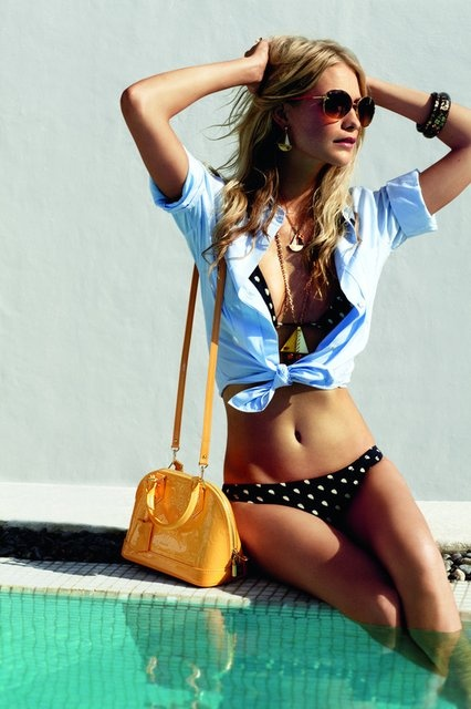 Wearing a Louis Vuitton Summer Handbag in a Polka Dot Bikini. Classic.