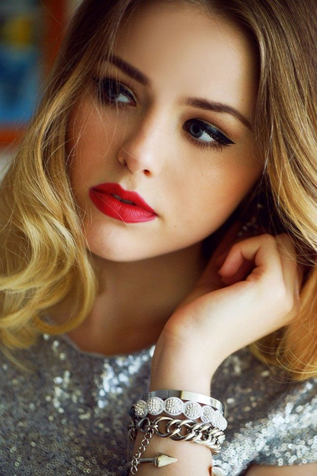 Pair a red lip and dark eye for the holidays.