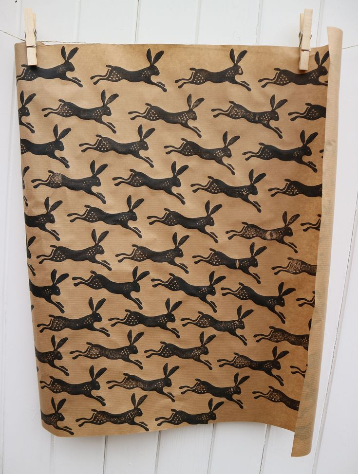 Hand Printed Leaping Hare Wrapping Paper, made by using brown wrapping paper purchased from Ikea and a pot of Black Acrylic Paint!
